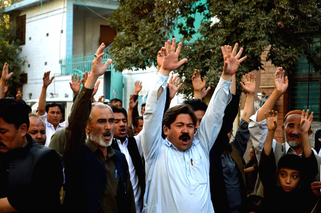 QUETTA, Oct. 5, 2016 - Pakistani Shiite Muslims shout slogans during a protest against the attack on a passenger bus in southwest Pakistan's Quetta, Oct. 5, 2016. At least four female Shiite ...