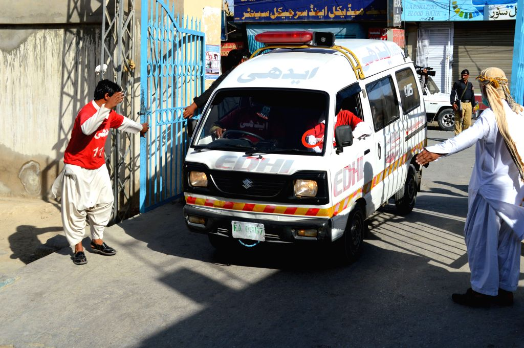 QUETTA, Oct. 7, 2016 - An ambulance carrying injured people arrives at a hospital in Quetta, Pakistan, Oct. 7, 2016. At least four people were killed and 16 others injured when twin blasts hit a ...