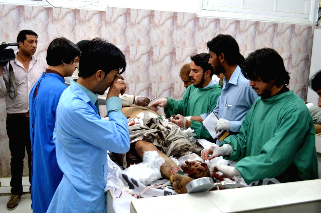 QUETTA, Oct. 7, 2016 - Doctors examine a body of a victim at a hospital in southwest Pakistan's Quetta, Oct. 7, 2016. At least four people were killed and 16 others injured when twin blasts hit a ...