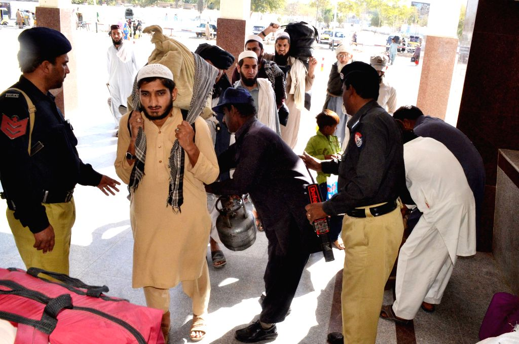 QUETTA, Oct. 8, 2016 - Pakistani policemen check passengers' luggages at a railway station in southwest Pakistan's Quetta, Oct. 8, 2016. At least eight people were killed and 19 others injured when ...