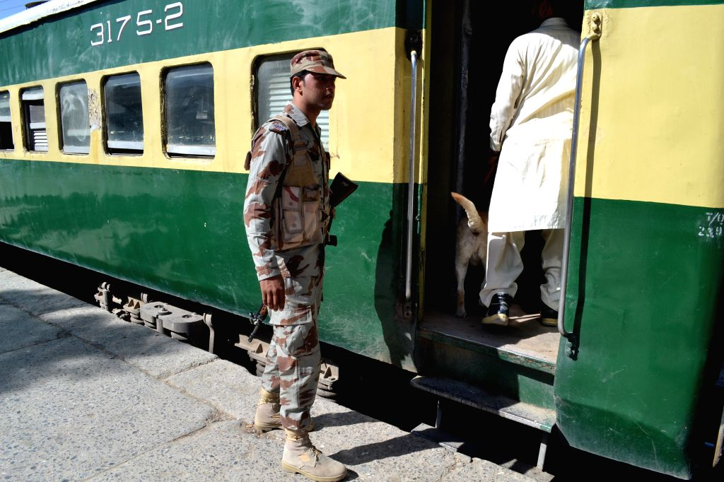 QUETTA, Oct. 8, 2016 - Pakistani security officials search a train before its departure at a railway station following twin blasts of a passenger train in Mach area of Balochistan, in southwest ...