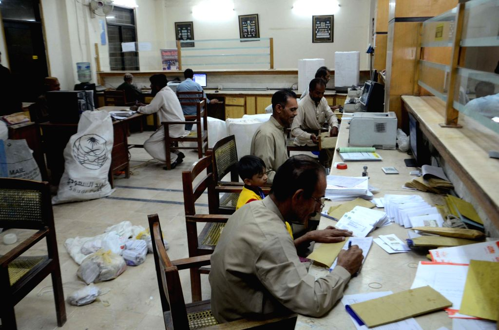 QUETTA, Oct. 9, 2016 - Employees work at a post office on the World Post Day in southwest Pakistan's Quetta, Oct. 9, 2016. World Post Day is celebrated each year on Oct. 9, the anniversary of the ...