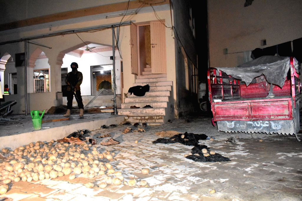 QUETTA (PAKISTAN), Jan. 10, 2020 A security member stands guard at the blast site in Quetta, Balochistan province, Pakistan, on Jan. 10, 2020. A blast hit a mosque in Quetta on Friday ...
