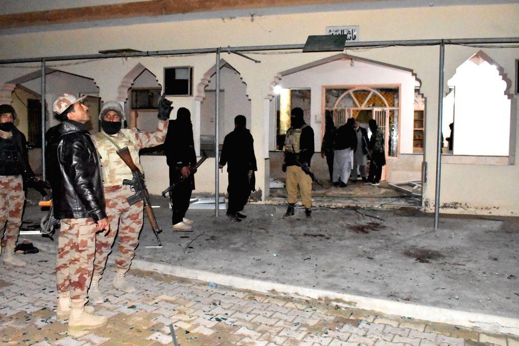 QUETTA (PAKISTAN), Jan. 10, 2020 Security members examine the blast site in Quetta, Balochistan province, Pakistan, on Jan. 10, 2020. A blast hit a mosque in Quetta on Friday night, ...
