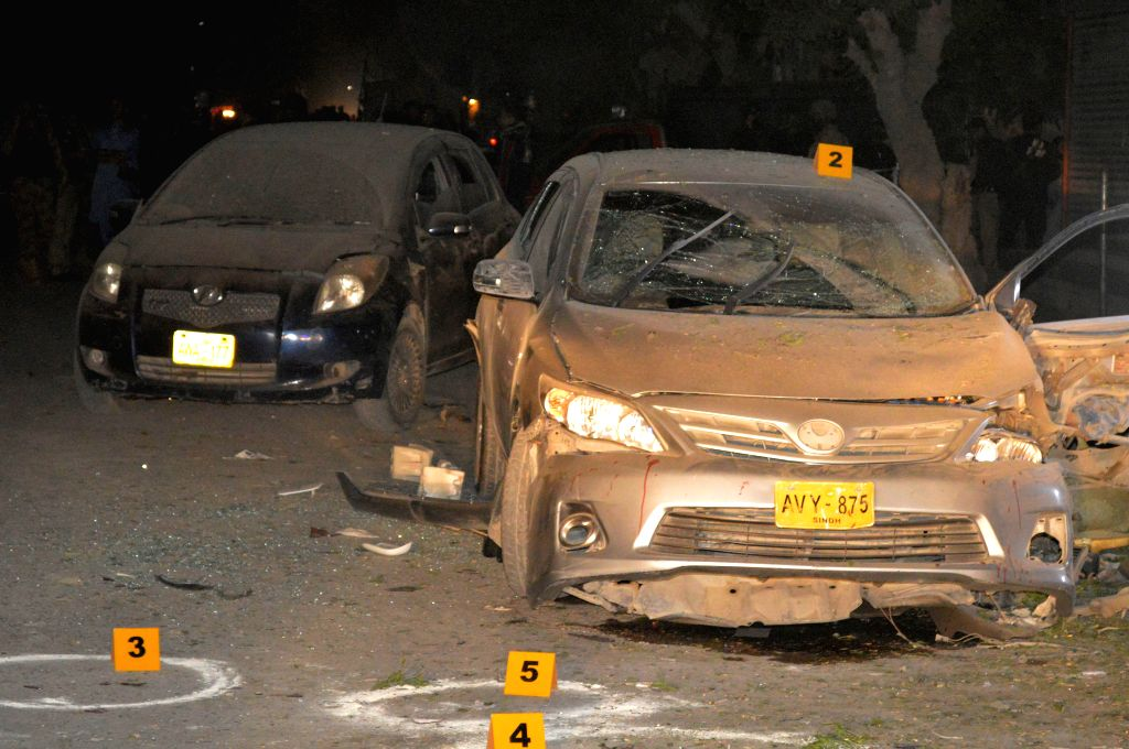 QUETTA (PAKISTAN), May 13, 2019 Damaged vehicles are seen at a bomb blast site in Quetta, southwest Pakistan, on May 13, 2019. At least two policemen were killed and 11 others injured on ...