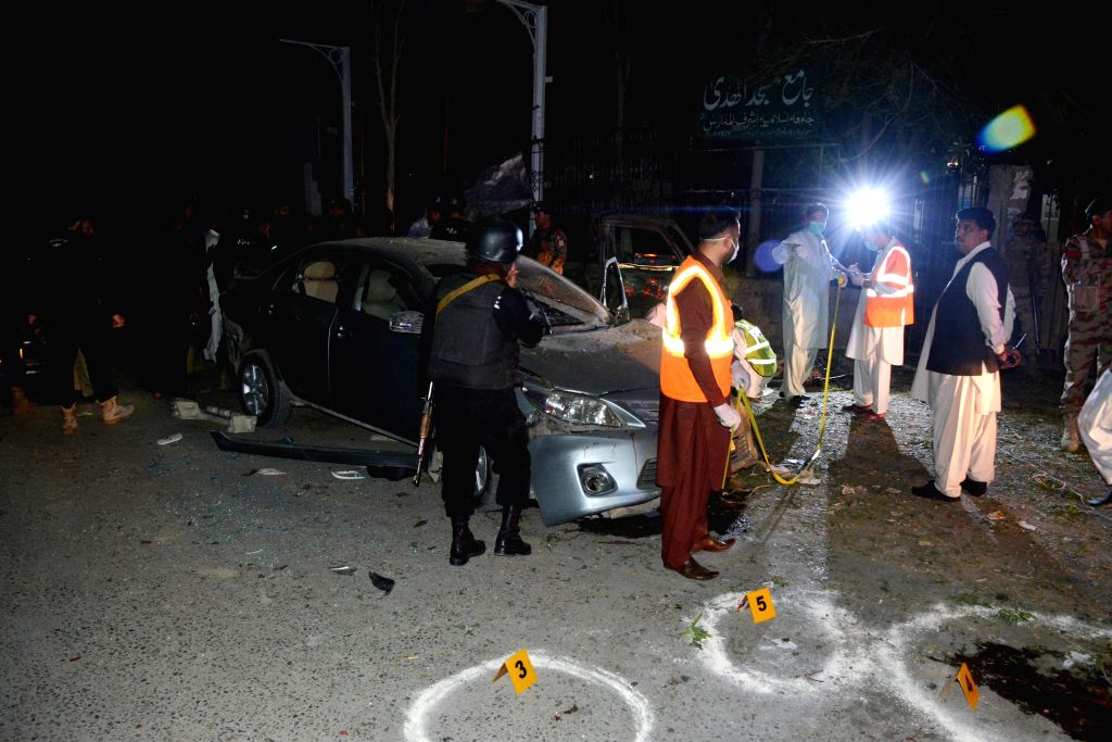 QUETTA (PAKISTAN), May 13, 2019 Security officials examine a bomb blast site in Quetta, southwest Pakistan, on May 13, 2019. At least two policemen were killed and 11 others injured on ...