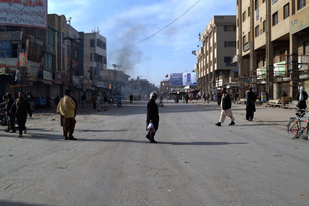 Quetta (Pakistan): Residents walk in a road during country-wide strike on the killing of Jamiat Ulema-e-Islam-Fazl (JUI-F) leader Dr. Khalid Mahmood Soomro in southwest Pakistan's Quetta, Nov. 30, ...