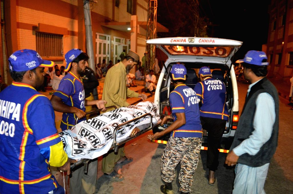 QUETTA, Sept. 11, 2017 - Rescuers transfer a body in southwest Pakistan's Quetta on Sept. 10, 2017. At least three people were killed and two others injured when some unknown gunmen targeted a ...