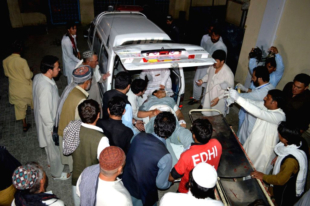 QUETTA, Sept. 11, 2017 - Rescuers transfer an injured man in southwest Pakistan's Quetta on Sept. 10, 2017. At least three people were killed and two others injured when some unknown gunmen targeted ...