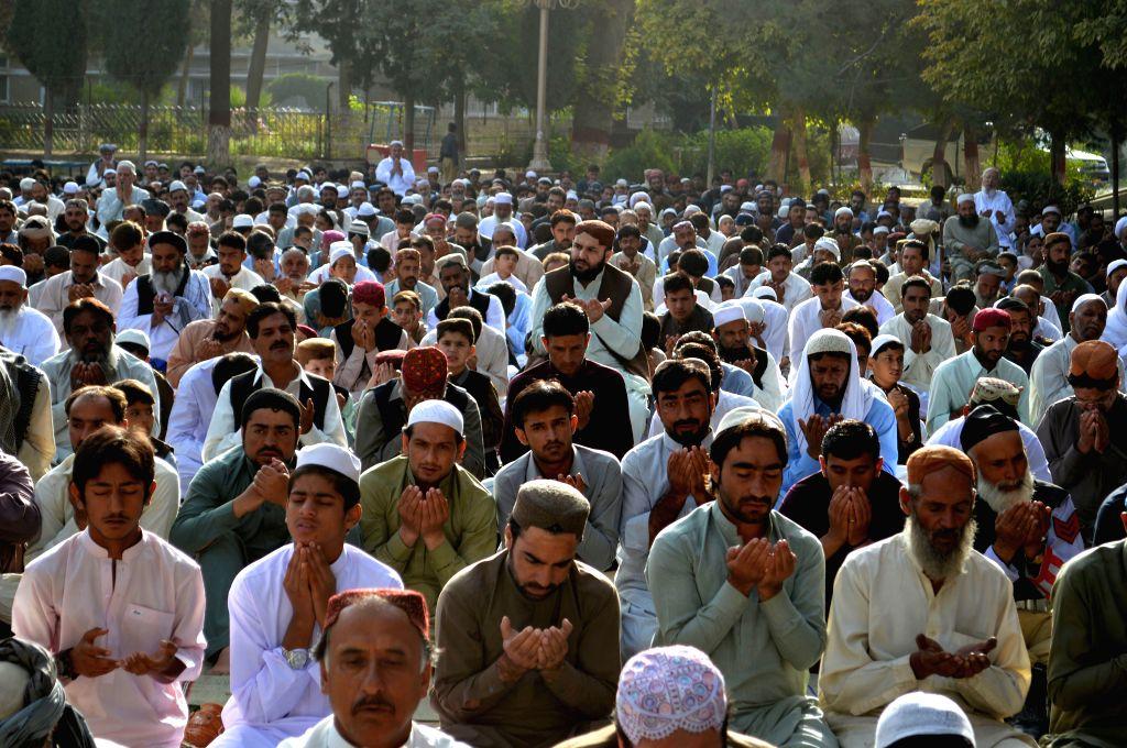 QUETTA, Sept. 13, 2016 - Pakistani Muslims offer Eid al-Adha prayers in southwest Pakistan's Quetta, Sept. 13, 2016. Muslims across the world celebrate the annual festival of Eid al-Adha, or the ...