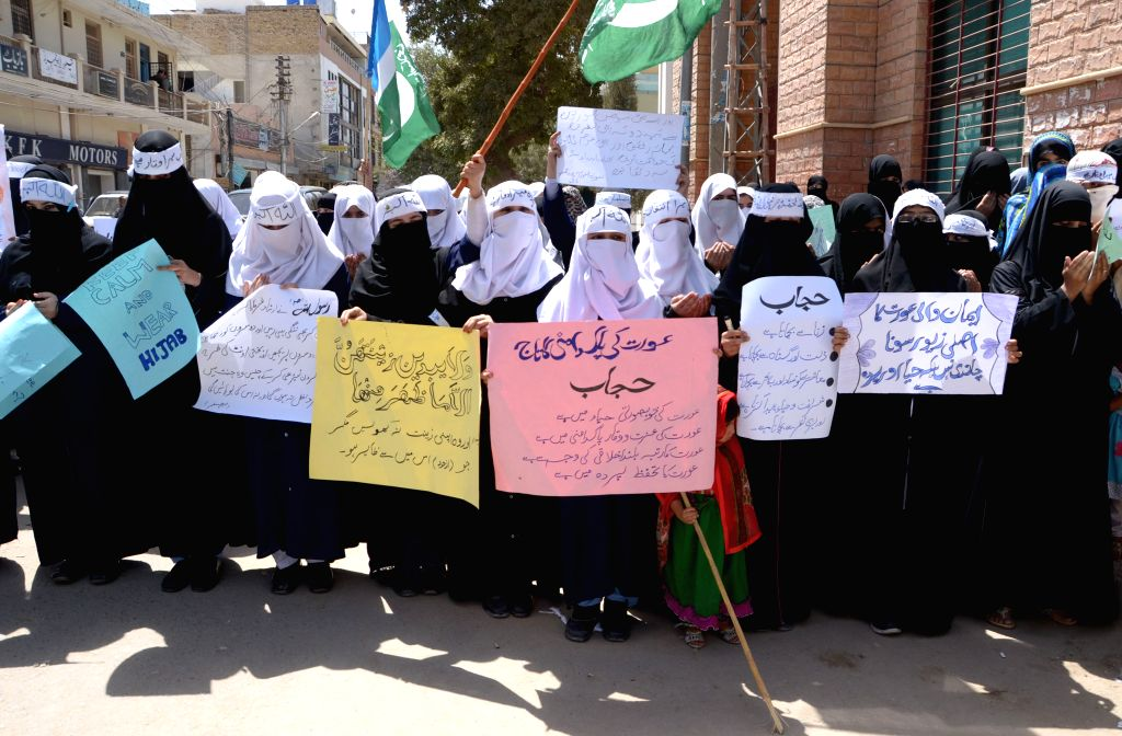 Pakistani women covering their faces with Hijab hold placards during a rally to mark World Hijab Day in southwest Pakistan's Quetta, Sept. 4, 2014. Nationwide ...