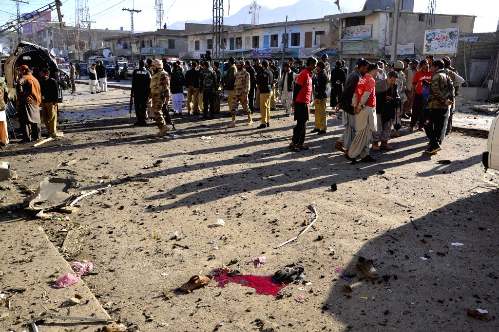 QuettaSecurity officials examine the blast site in southwest Pakistan's Quetta, Dec. 4, 2014. At least one man was killed and nine others wounded when a bomb exploded near a vegetable market in ...