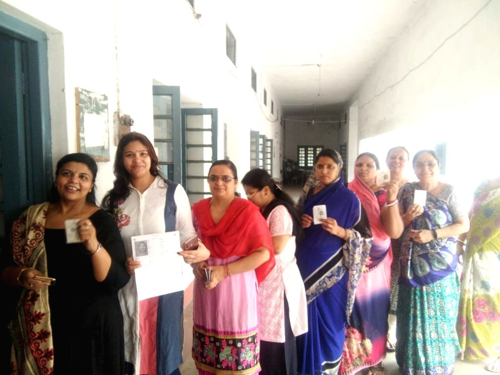 Queue up to cast their votes during the sixth phase of 2019 Lok Sabha elections, in Dhanbad, Jharkhand on May 12, 2019.