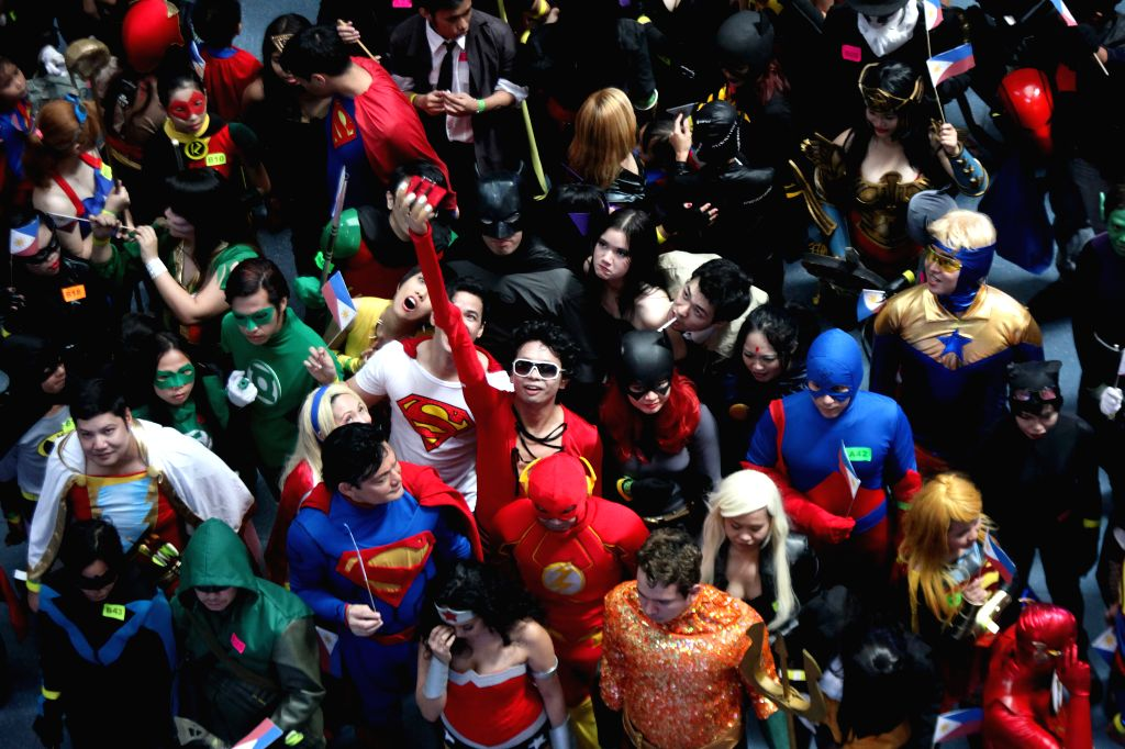 People dressed as superheroes gather as they participate in the Super Hero World Record event in Quezon City, the Philippines, April 18, 2015. The event is ...