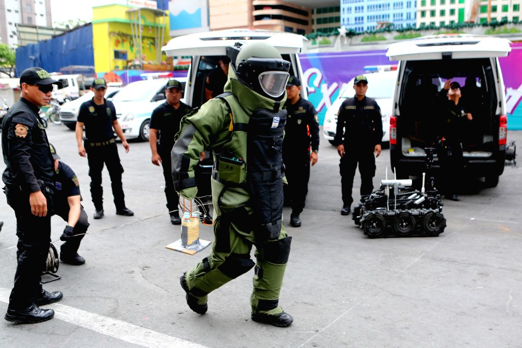 QUEZON CITY, April 9, 2019 - A member of the Philippine National Police in a bomb suit participates in a bomb drill in Quezon City, the Philippines, April. 9, 2019. The Philippine National Police ...