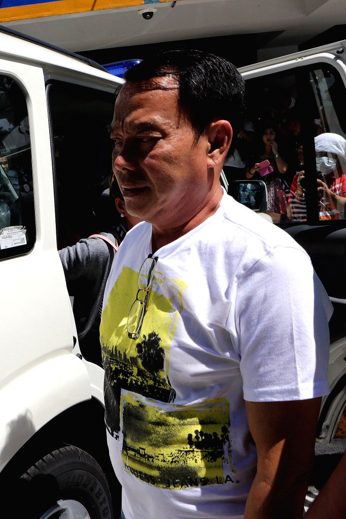 QUEZON CITY, Aug. 3, 2016 - Rolando Espinosa, mayor of Albuera, Leyte Province, arrives at the Criminal Investigation and Detection Group (CIDG) to present himself at the Philippine National Police ...