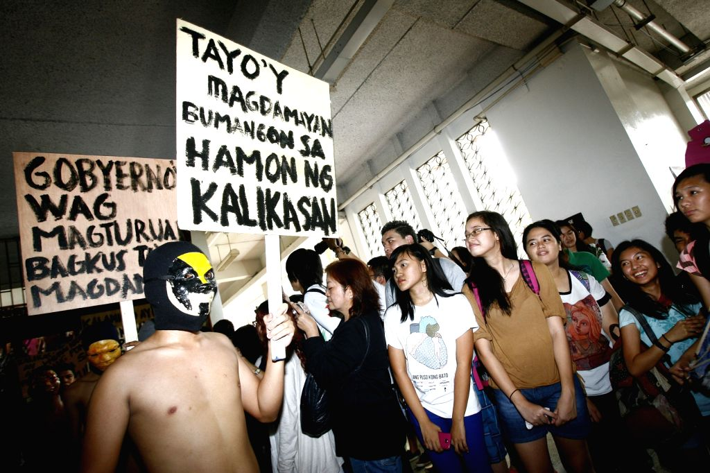 """Student members of the Alpha Phi Omega fraternity are seen naked during the 36th annual """"oblation run"""" to urge the government to strengthen the .."""