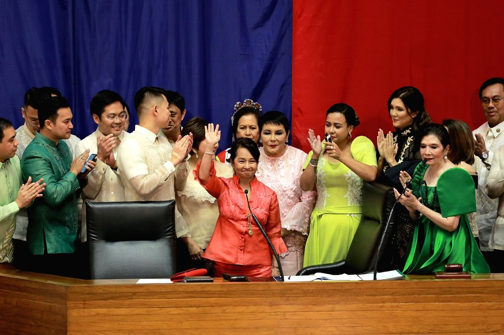 QUEZON CITY, July 23, 2018 - Former Philippine President and current Representative Gloria Arroyo (C) waves to her colleagues after being elected as new Speaker of the House of Representatives in ... - Pantaleon Alvarez
