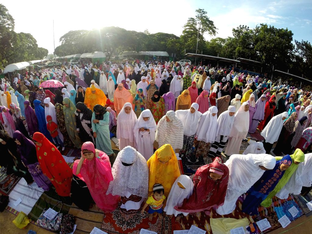 Muslims pray during the Eid al-Fitr celebration in Quezon City, Philippines on July 28, 2014. Muslims around the world celebrate the Eid al-Fitr festival, ...