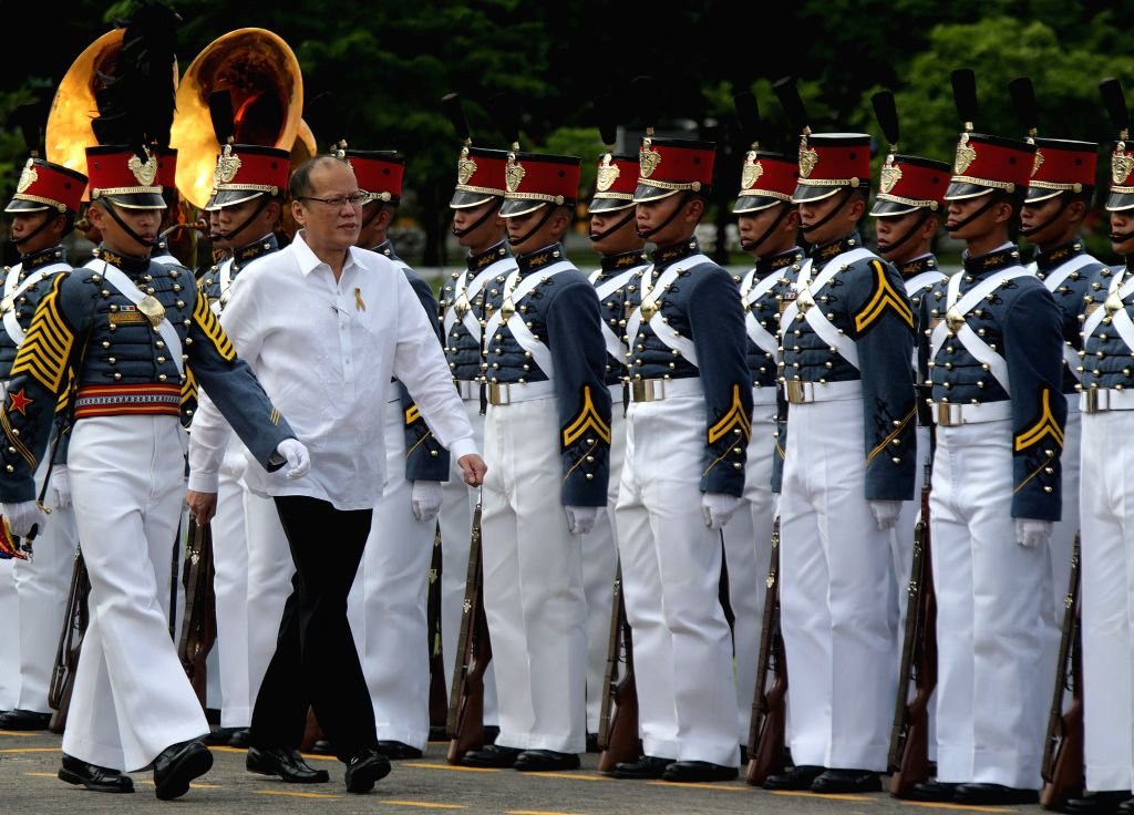 QUEZON CITY, June 27, 2016 - Outgoing Philippine President Benigno S. Aquino III (2nd L, front) walks in front of soldiers from the Armed Forces of the Philippines (AFP) during the testimonial parade ...