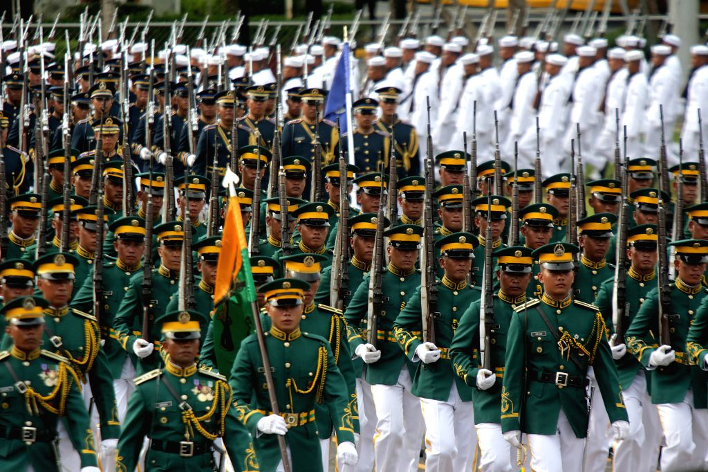 QUEZON CITY, June 27, 2016 - Soldiers from the Armed Forces of the Philippines (AFP) march during the testimonial parade for outgoing Philippine President Benigno S. Aquino III inside Camp Aguinaldo ...