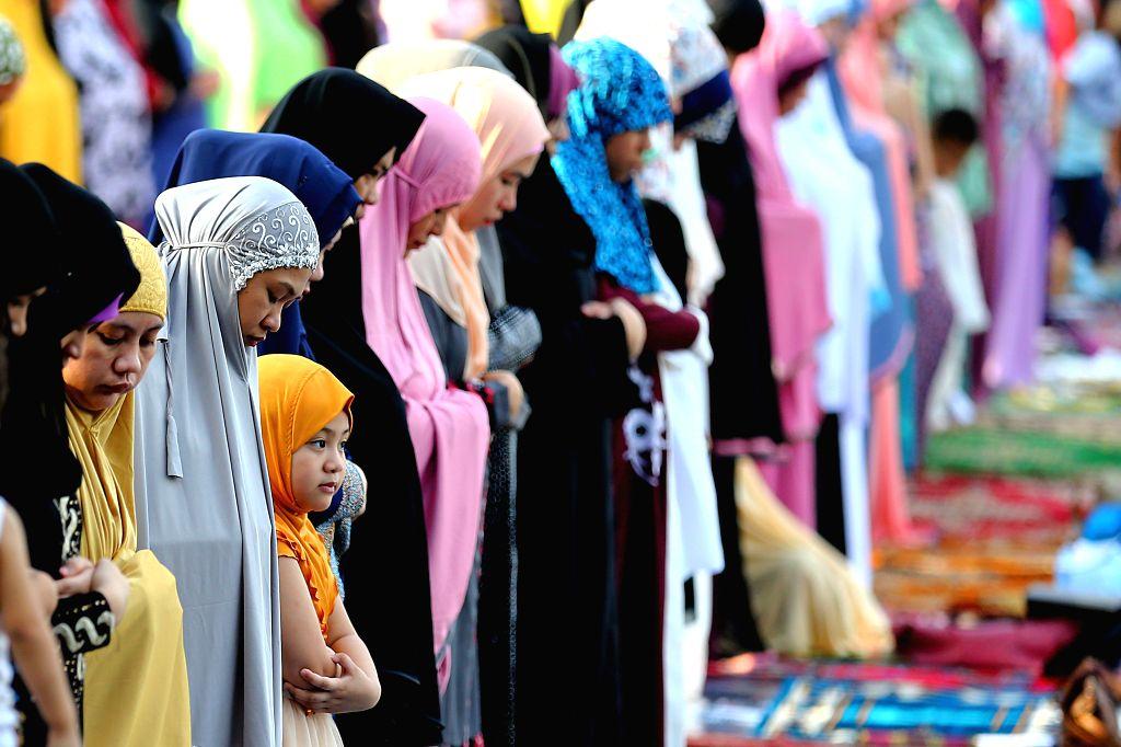 QUEZON CITY, June 5, 2019 - Muslim women attend Eid al-Fitr prayers in Quezon City, the Philippines, June 5, 2019.