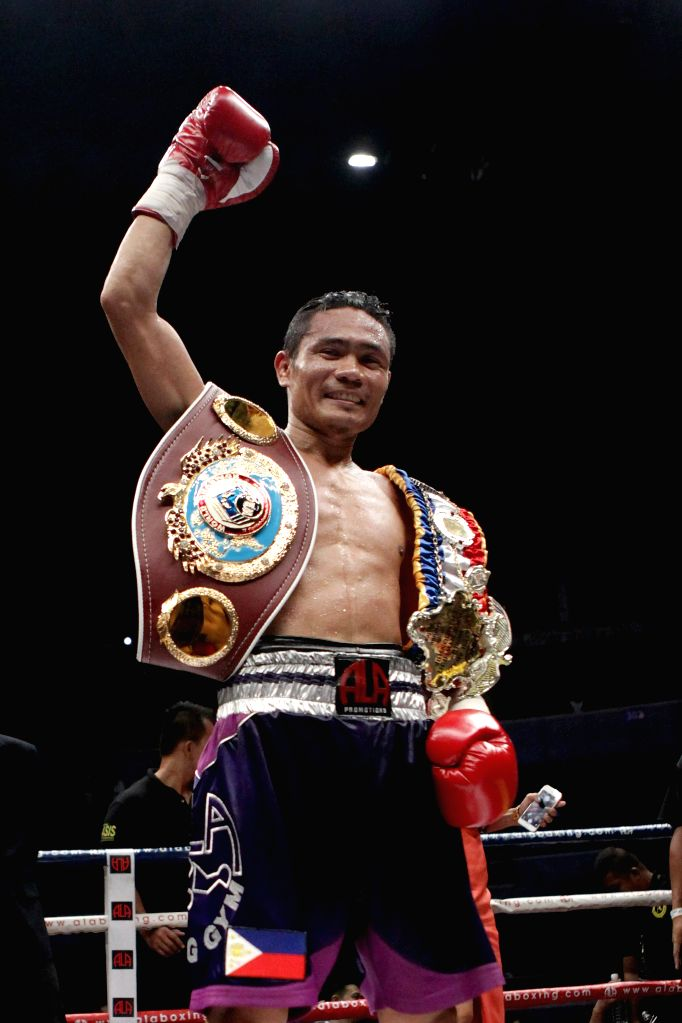 Donnie Nietes of the Philippines celebrates after winning his fight against Gilberto Parra of Mexico during their WBO World Juniour Flyweight Championship ...