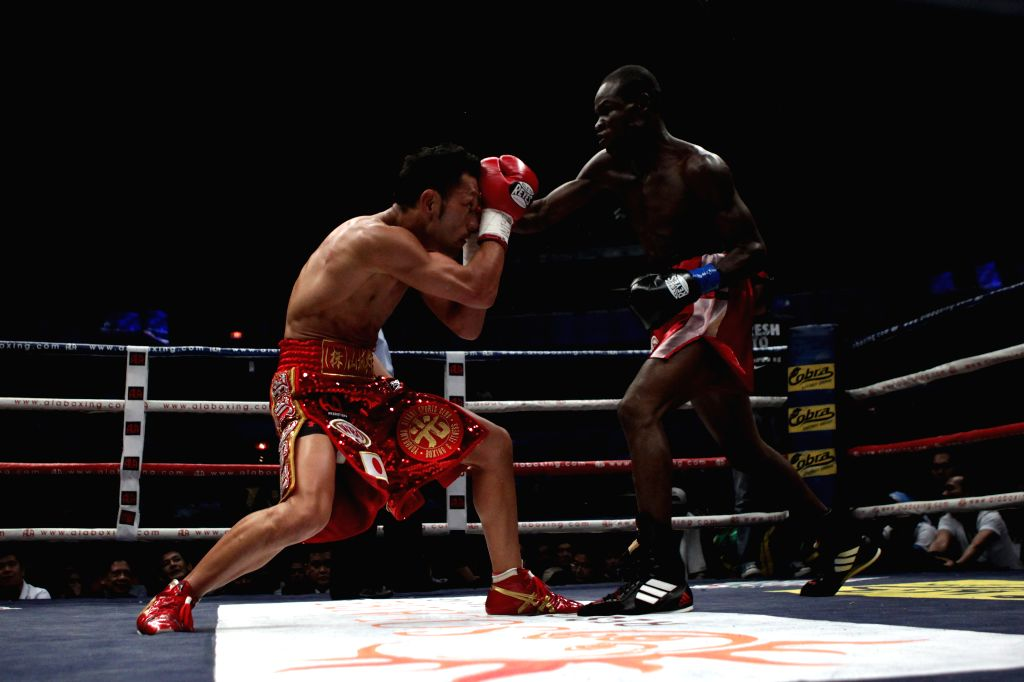 Prosper Ankrah (R) of Ghana fights against Ryo Akaho of Japan during their WBO International Bantamweight Championship match in Quezon City, Philippines on ...