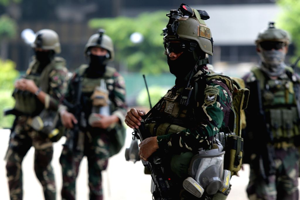 QUEZON CITY, May 24, 2016 - Soldiers from the Armed Forces of the Philippines (AFP) gather to secure the ballot boxes containing certificates of canvass at the House of Representatives in Quezon ...