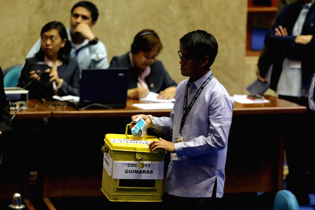 QUEZON CITY, May 25, 2016 - A staff member from the Philippine Congress carries a ballot box during the official counting of votes from the May 9 elections of president and vice president at the ...