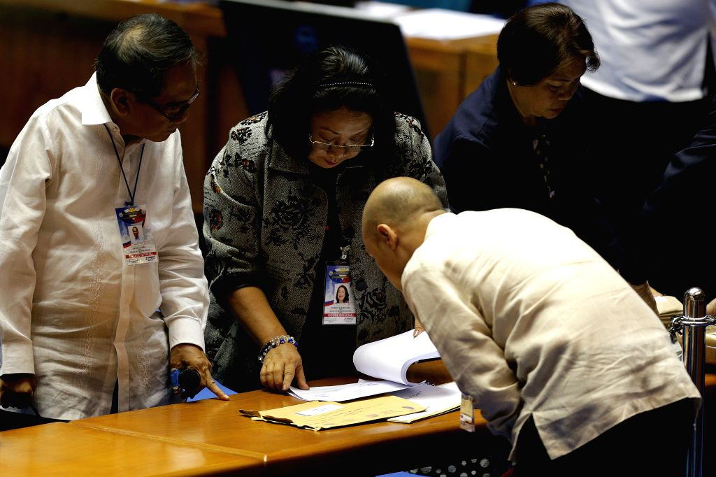 QUEZON CITY, May 25, 2016 - Senates, Congress officials and election lawyers check the ballots during the official counting of votes from the May 9 elections of president and vice president at the ...