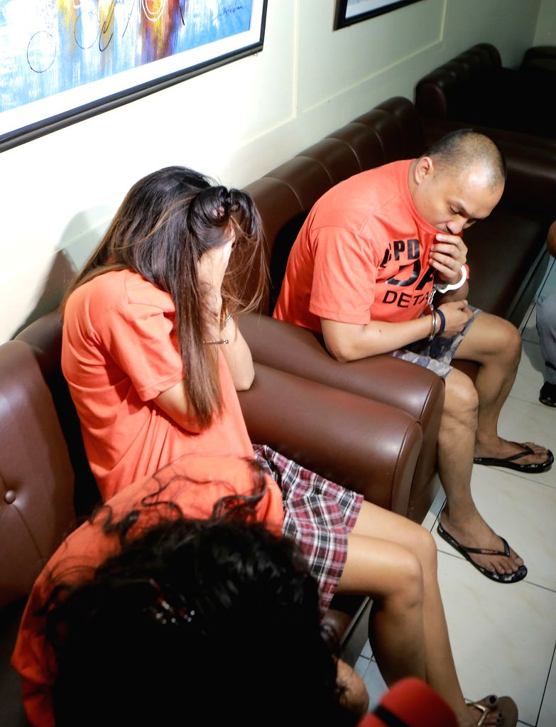 QUEZON CITY, Oct. 5, 2016 - Arrested illegal drug dealers cover their face during a press conference inside Camp Karingal in Quezon City, the Philippines, Oct. 5, 2016. Php2.79 million pesos worth of ...