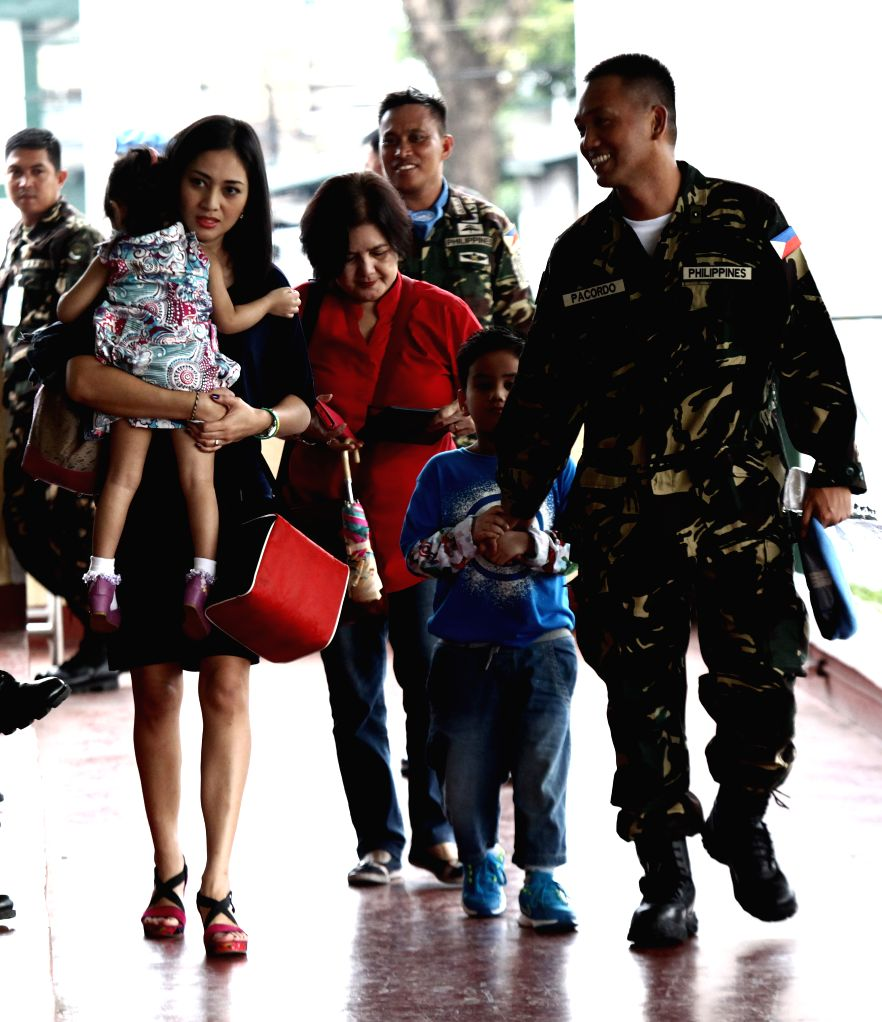 Quezon City: Philippine UN peacekeepers join their relatives inside Camp Aguinaldo in Quezon City, the Philippines, Dec. 4, 2014. The UN peacekeepers from Ebola-stricken Liberia met with their ...