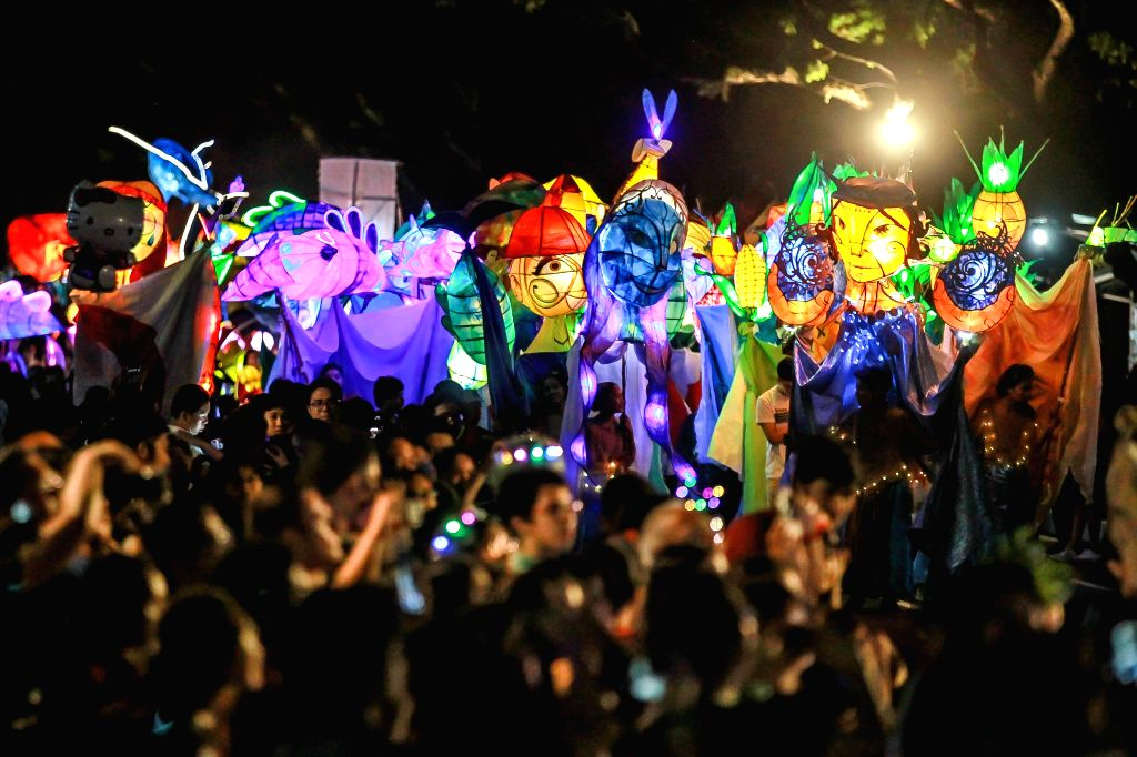 QUEZON, Dec. 13, 2019 - Students dressed in costumes march with colorful lanterns during the annual Lantern Parade at the University of the Philippines in Quezon City, the Philippines, Dec. 13, 2019.