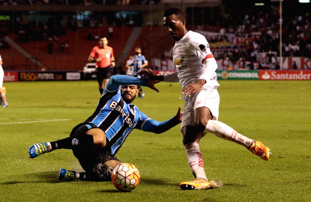 QUITO, April 14, 2016 - Julio Ayovi (R) of Ecuador's Liga Sports University vies with Douglas of Brazil's Gremio during the match of the group stage of the Libertadores Cup at Casa Blanca, in Quito, ...
