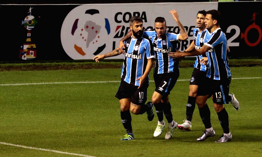 QUITO, April 14, 2016 - Players of Brazil's Gremio celebrate scoring during the match of the group stage of the Libertadores Cup against Ecuador's Liga Sports University at Casa Blanca, in Quito, ...