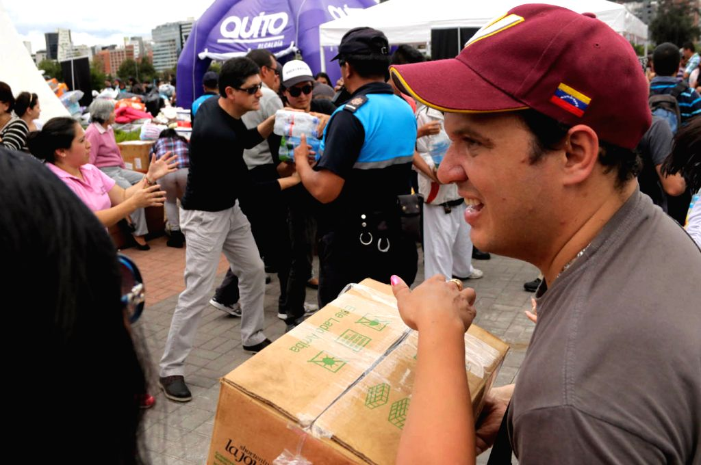 QUITO, April 18, 2016 - Venezuelans living in Ecuador collect humanitarian aid in a collection center in Quito, Ecuador, on April 17, 2016. The number of victims of a devastating earthquake that ...