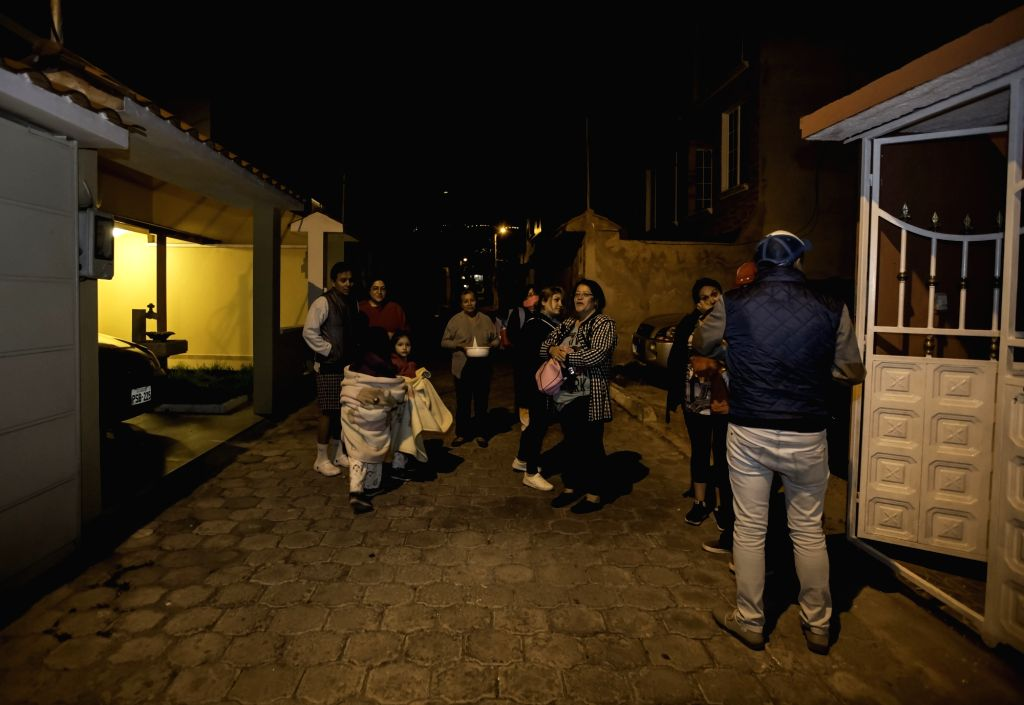 QUITO, July 11, 2016 - People stay on a street after earthquakes in Quito, Ecuador, on July 10, 2016. Two strong earthquakes struck the northwest coast of Ecuador on Sunday night. Authorities said ...