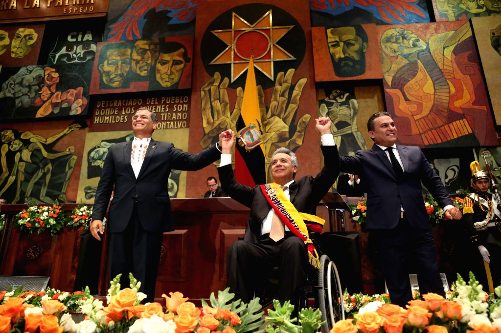 QUITO, May 24, 2017 - Photo provided by Ecuador's Presidency shows Lenin Moreno (C) and Ecuador's outgoing President Rafael Correa (L) gesturing during the swearing-in ceremony of Moreno in Quito, ...