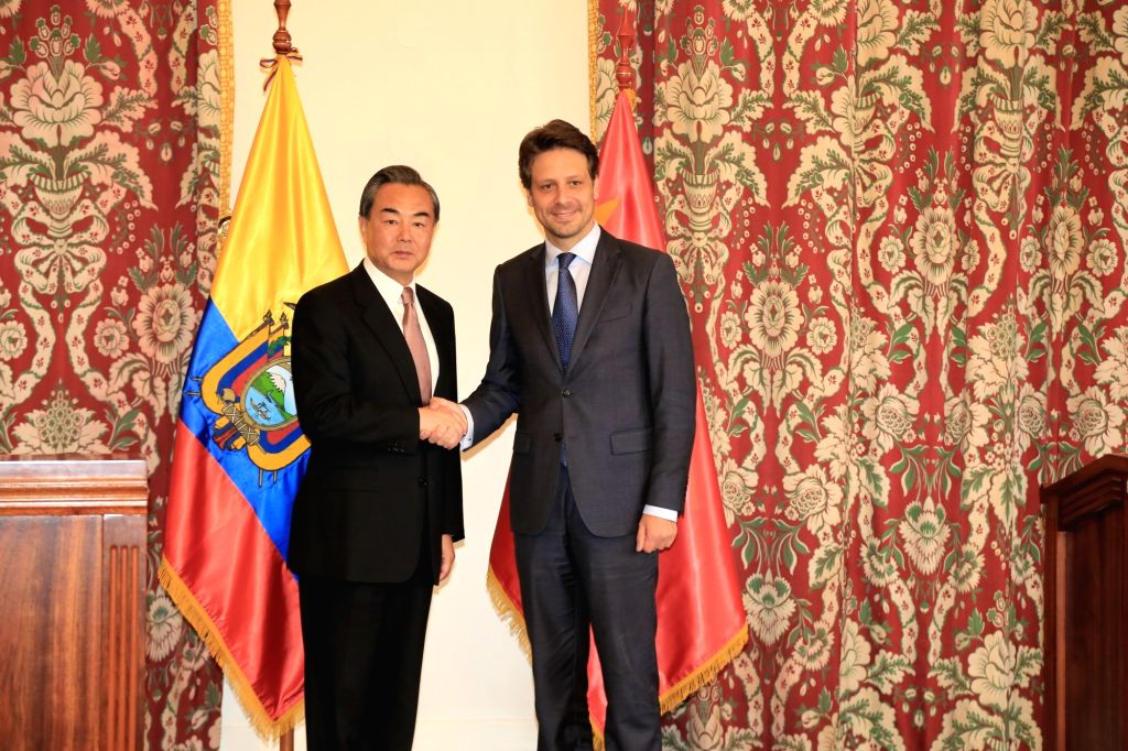 QUITO, Oct. 5, 2016 - Chinese Foreign Minister Wang Yi (L) attends a joint press conference with his Ecuadorian counterpart Guillaume Long after a meeting in Quito, capital of Ecuador, on Oct. 4, ... - Wang Y