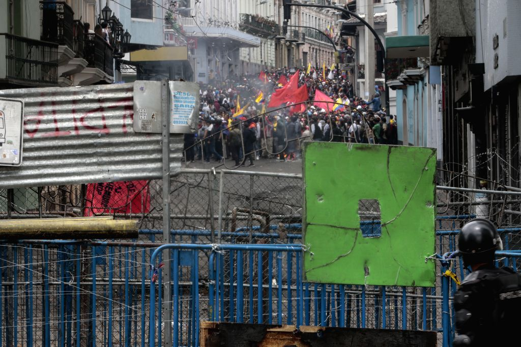 QUITO, Oct. 9, 2019 - Protesters confront the police in Quito, Ecuador, on Oct. 9, 2019. The Ecuadorian government Tuesday said it has asked the United Nations to help restore social peace as ...