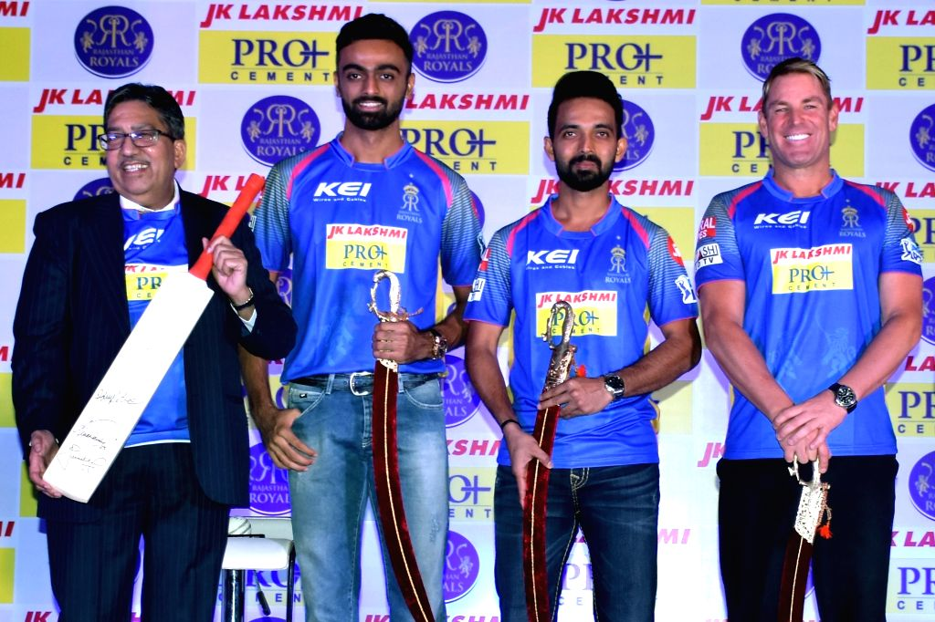 (R to L) Rajasthan Royals' head coach Shane Warne, skipper Ajinkya Rahane and Jaydev Unadkat during the launch of their team's new jersey in Jaipur on April 5, 2018.