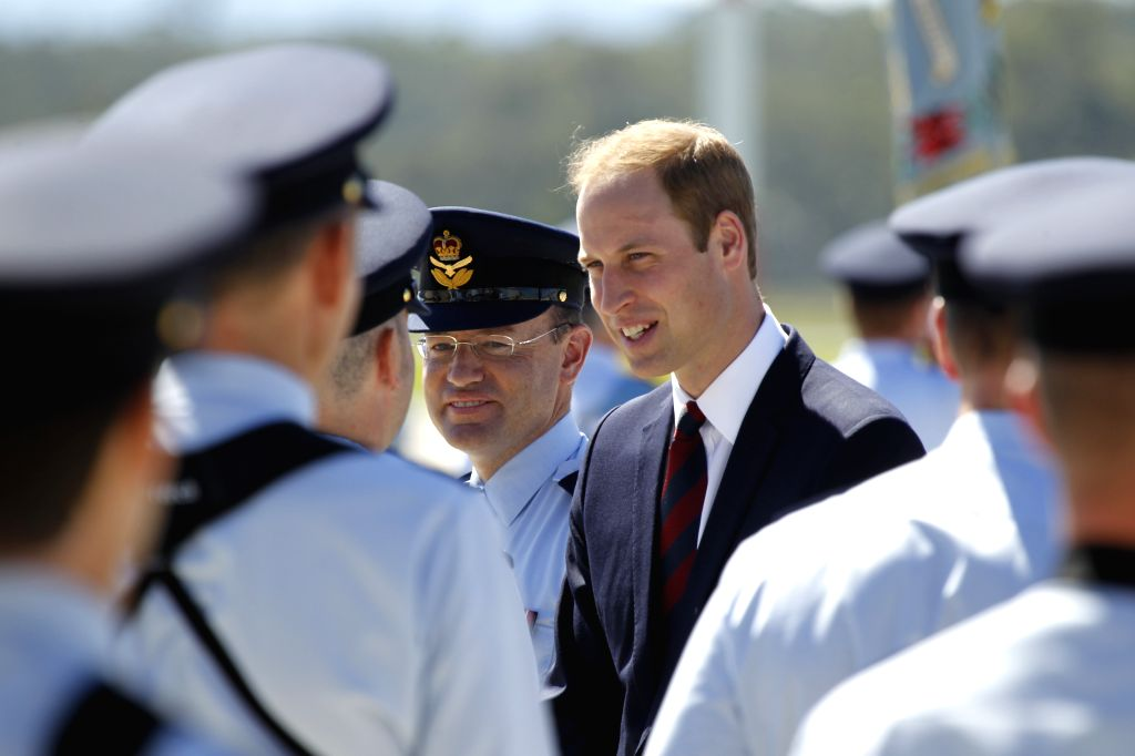 British Prince William speaks to a member of the Air Force Band after reviewing the Royal Guard at the RAAF Base Amberley, near Brisbane, Australia, ...
