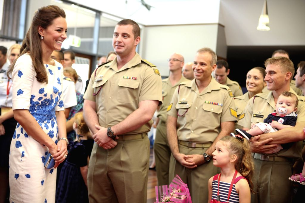 British Prince William's wife Kate (L), Duchess of Cambridge, speaks with Captain William Morrison and other personnel from 9th Field Support Battalion . - William Morrison