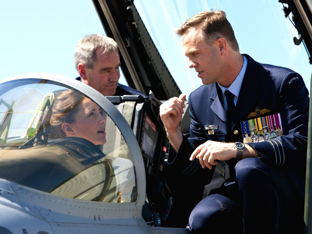 British Prince William's wife Kate (L), sits in the cockpit of an F/A-18F Super Hornet as Commanding Officer No. 1 Squadron, Wing Commander Stephen ...