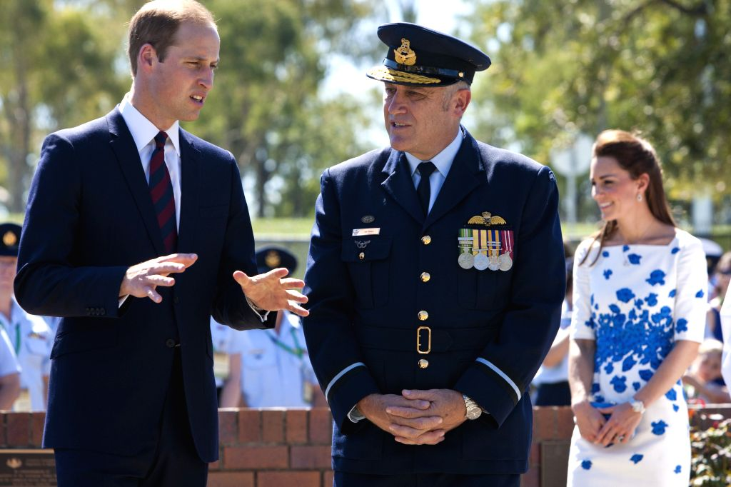 British Prince William (L) talks with Senior Australian Defence Force Officer, Air Commodore Tim Innes at the RAAF Base Amberley, near Brisbane, ...