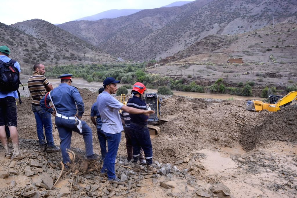 RABAT, July 26, 2019 - Rescuers work at a landslide site in Tuk Al-Khair, Morocco, on July 25, 2019. A total of 15 people, who were killed by the landslide in southern Morocco, were unearthed on ...