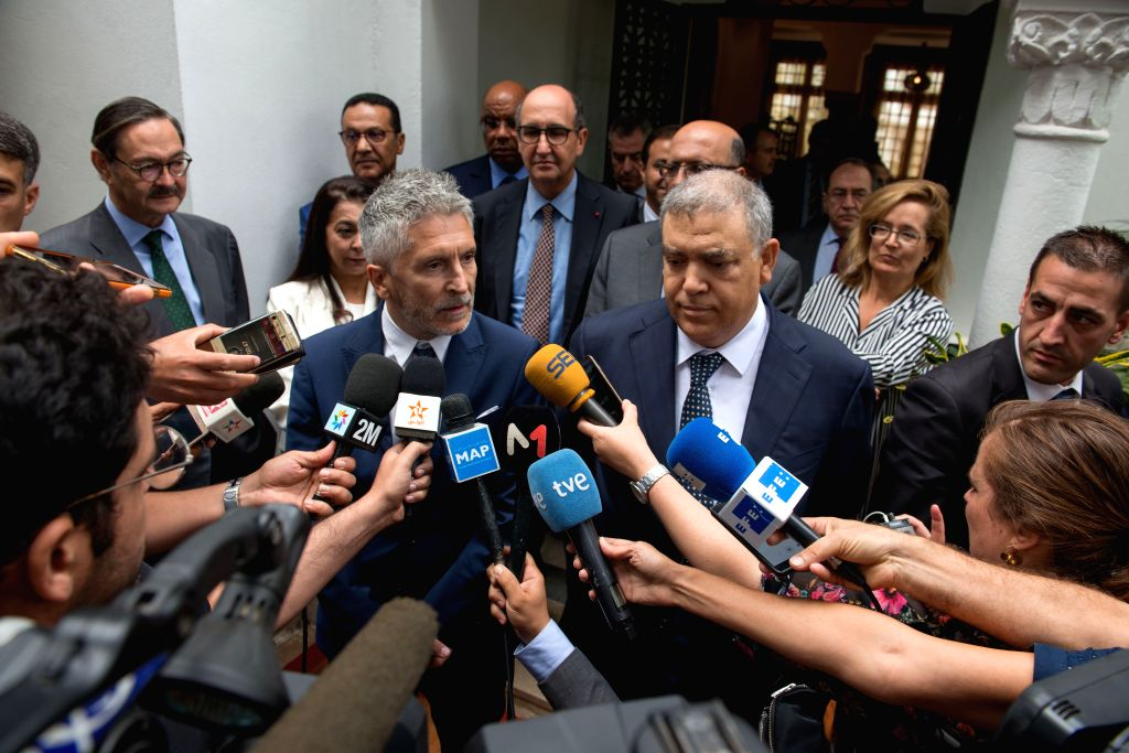 RABAT, Sept. 4, 2019 - Moroccan Interior Minister Abdelouafi Laftit (C-R) and his Spanish counterpart Fernando Grande-Marlaska (C-L) respond to media in Rabat, Morocco, on Sept. 4, 2019. Moroccan ... - Abdelouafi Laftit