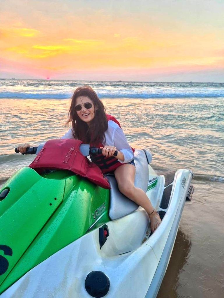 Radhika Madan poses on a jet ski.