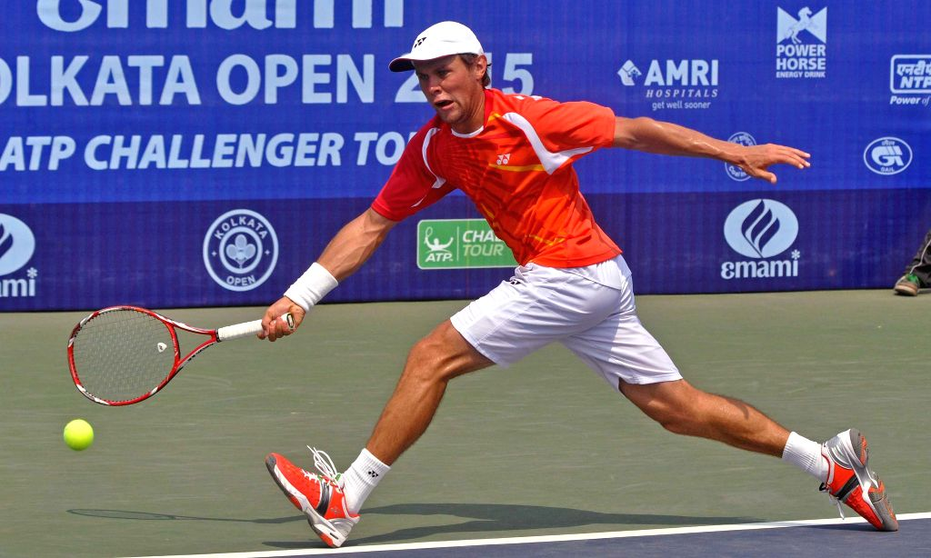 Radu Albot of Moldova in action against Taiwanese tennis player Chen Ti during an Emami Kolkata Open 2015- ATP Challenger semi-final match in Kolkata on Feb 27, 2015.
